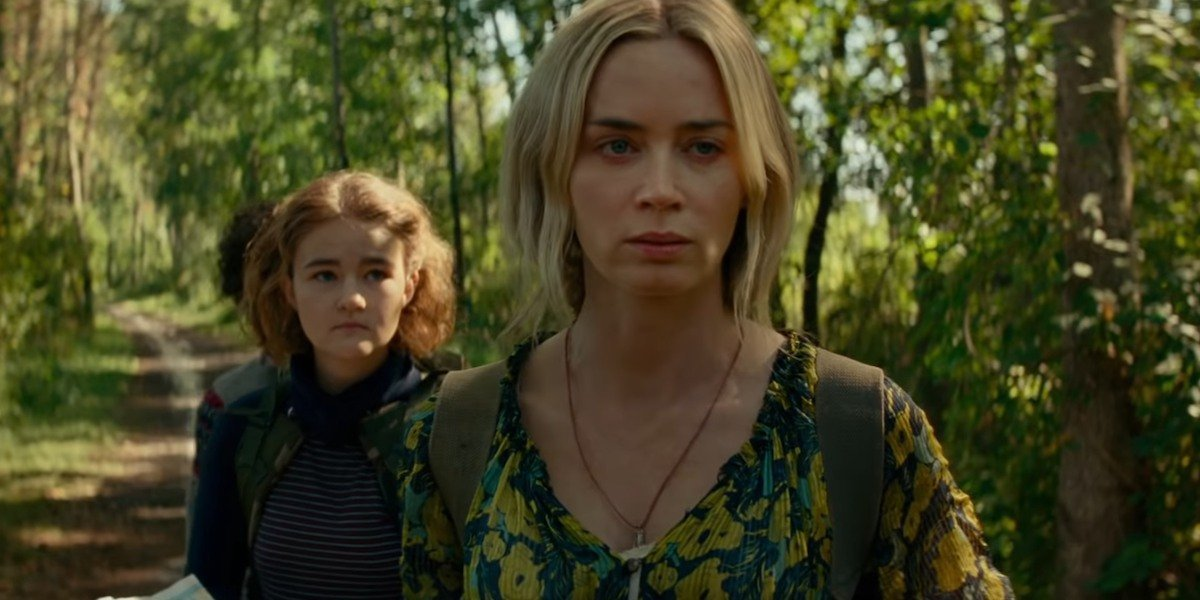 Noah Jupe, Millicent Simmonds, and Emily Blunt look worried in 'A Quiet Place Part II'