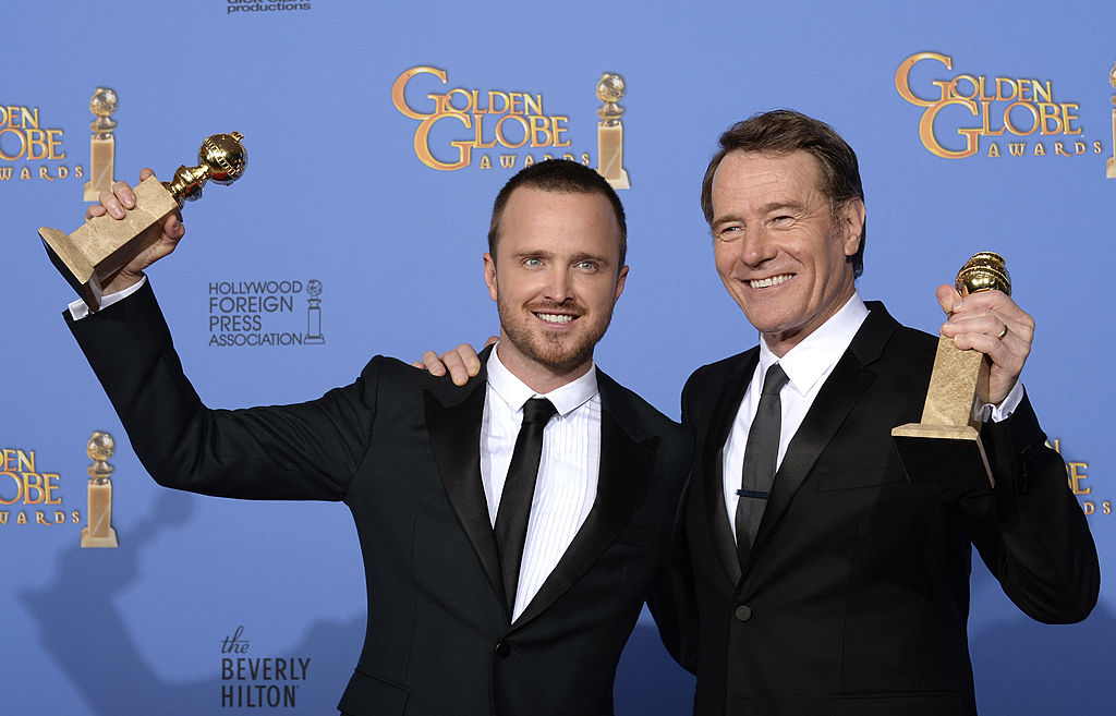 Aaron Paul poses with the award for Best Drama Series and actor Bryan Cranston poses with his award for Best Male Performance in a Television Series – Drama for 'Breaking Bad' in the press room holding their statues