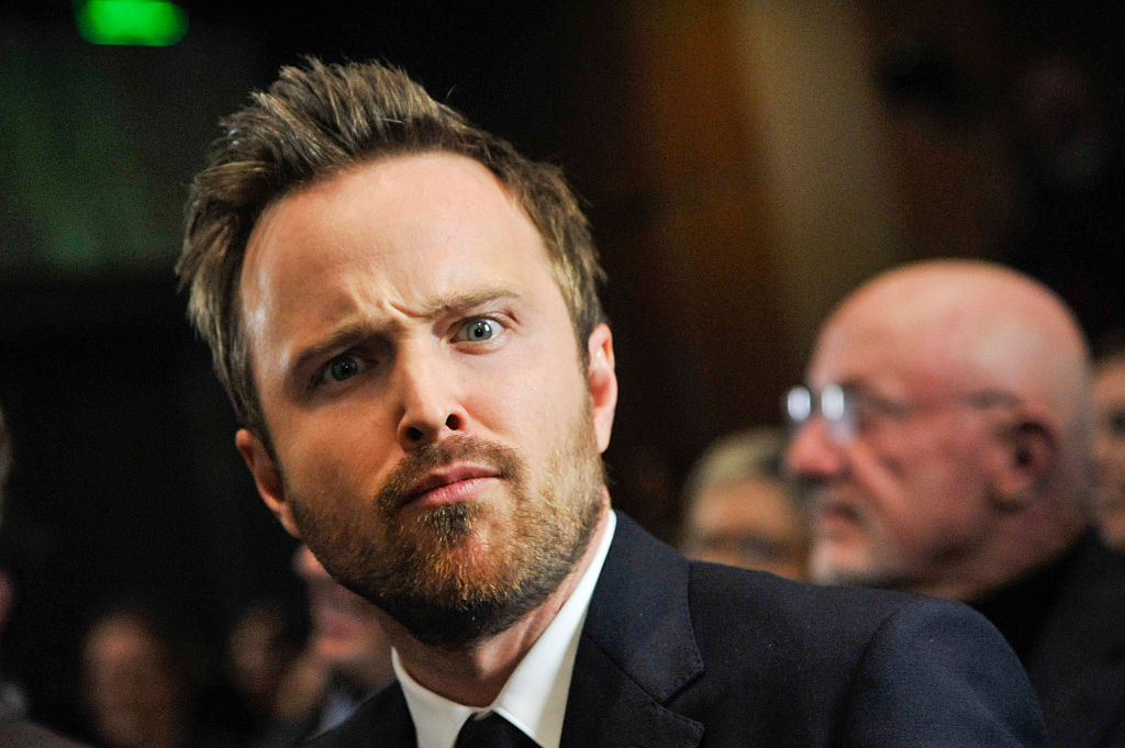 'Breaking Bad' star Aaron Paul walks a red carpet with a funny look on his face.