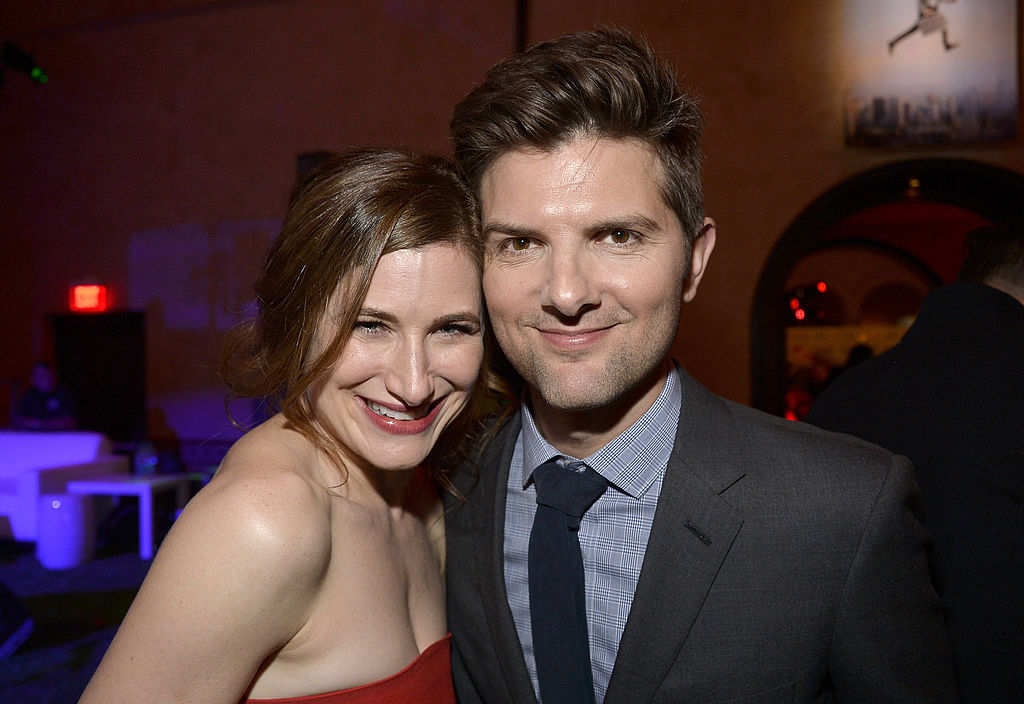 Kathryn Hahn and Adam Scott pose together at the premiere of 'The Secret Life of Walter Mitty'.