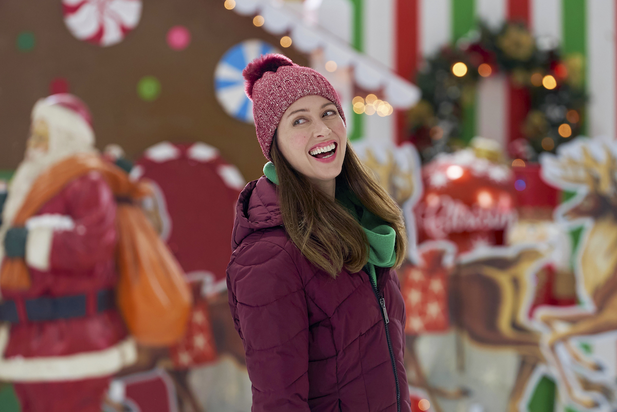 Amy Acker as Maggie wearing a knit hat and smiling