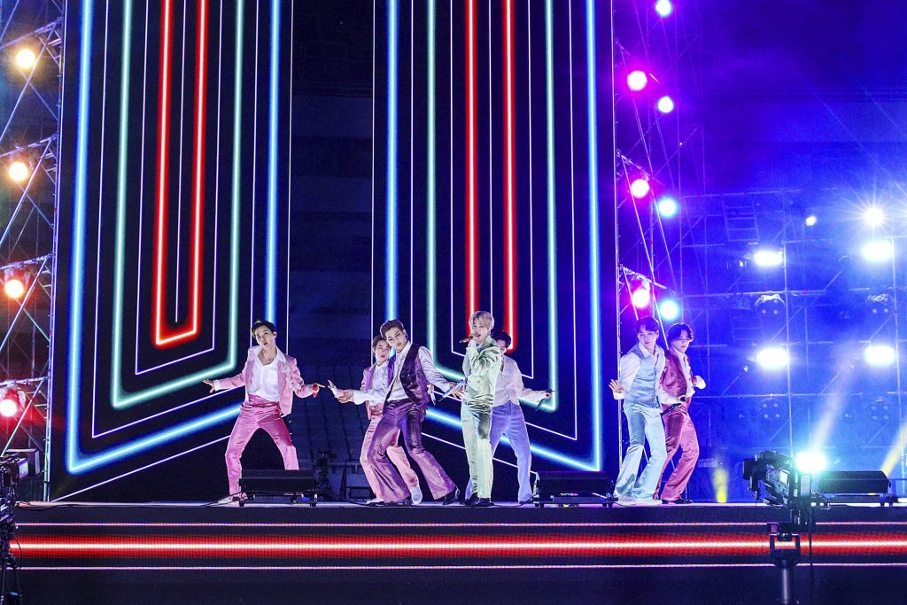 J-Hope, Jin, RM, Jimin, V, Suga, and Jungkook of BTS perform on stage for the 2020 American Music Awards
