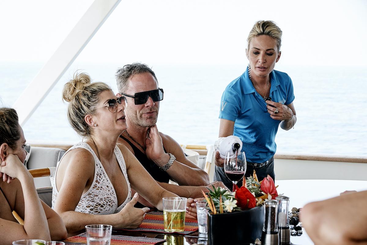 Kate Chastain serves Below Deck charter guests Alexis Bellino, Andy Bohn