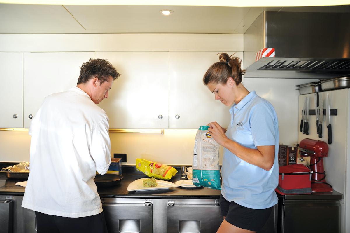 Ben Robinson, Samantha Orme work in the galley kitchen on Below Deck