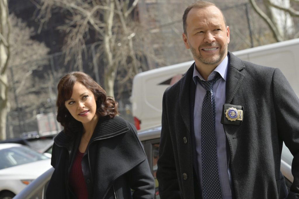 Maria Baez (Marisa Ramirez) looks at Danny Reagan (Donnie Wahlberg) as they stand on the street in 'Blue Bloods'