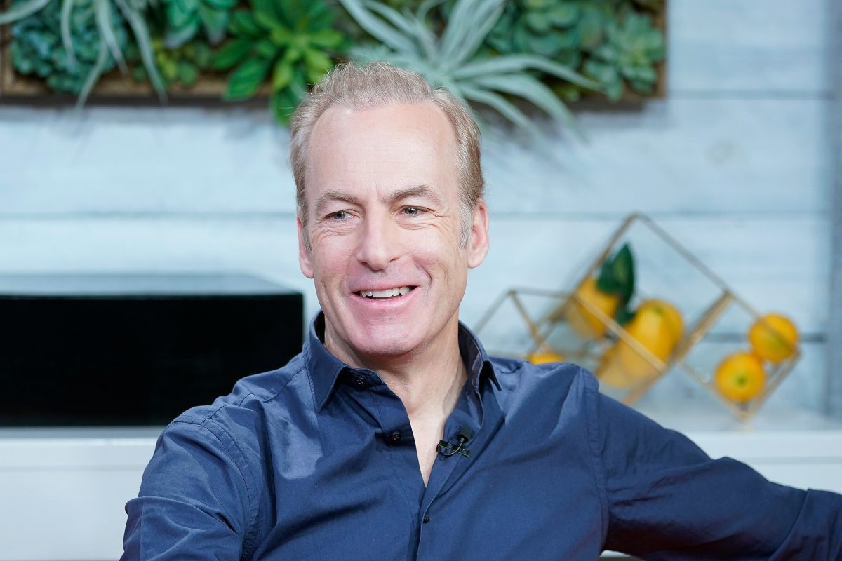 Bob Odenkirk wearing a blue button-up shirt and smiling