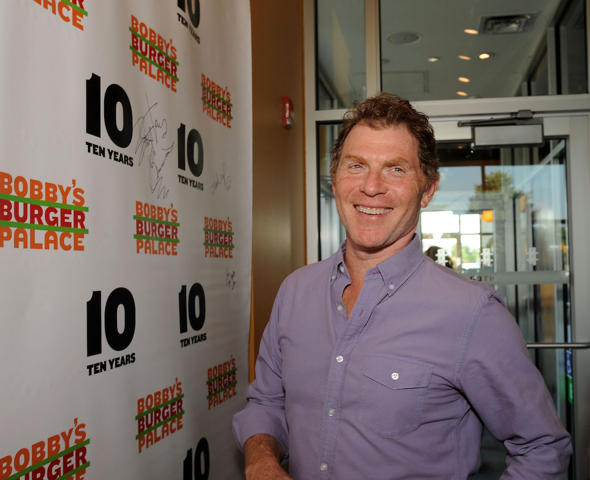 Bobby Flay smiles as he attends his Bobby's Burger Palace 10 Year Celebration in 2018