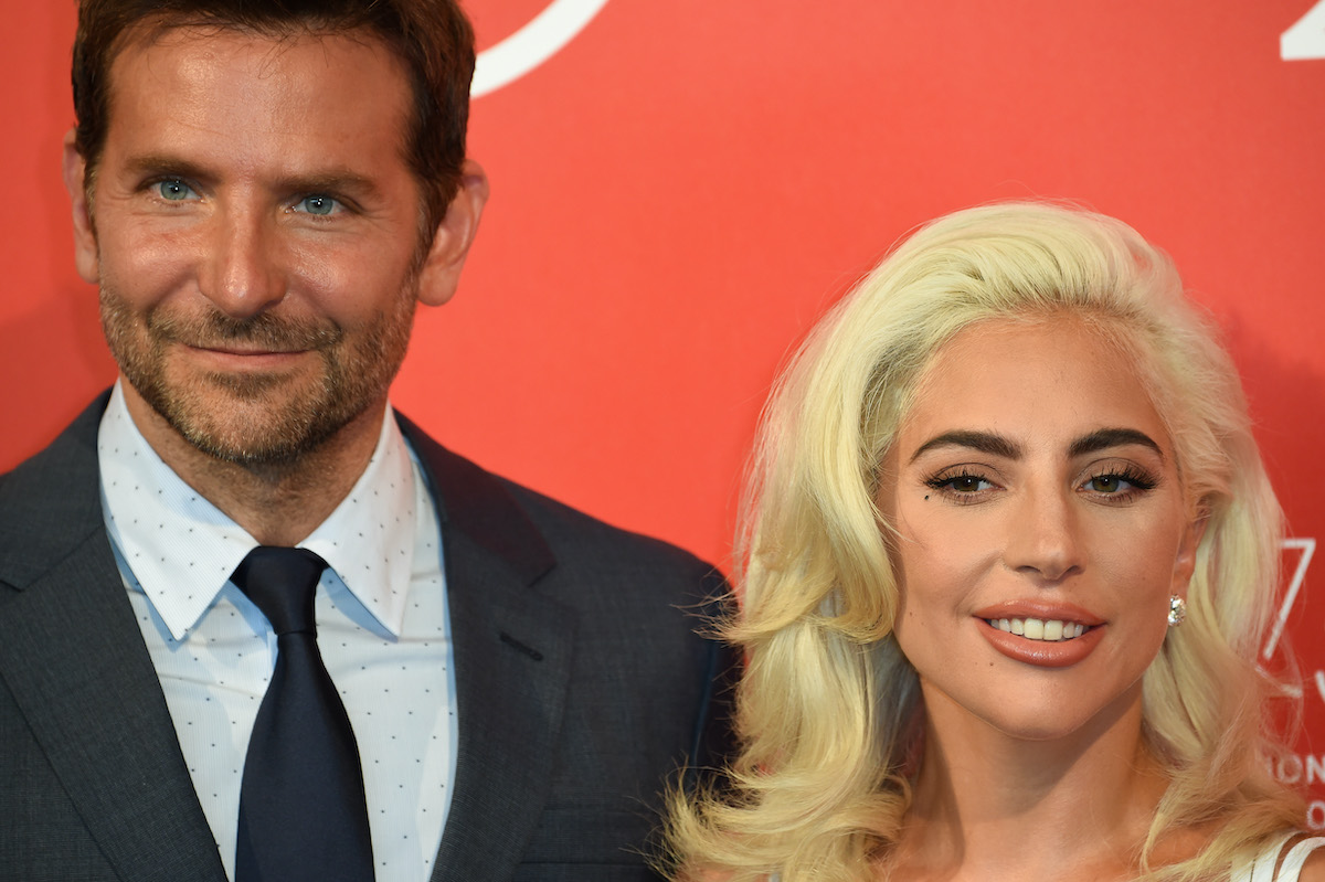 Bradley Cooper and Lady Gaga pose at a red carpet event