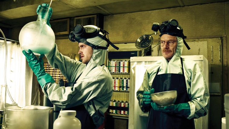 Bryan Cranston and Aaron Paul are dressed in hazmat suits as they mix up their Blue Sky product.