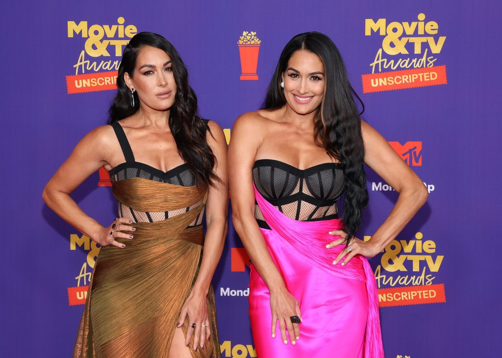 (L-R) Brie Bella and Nikki Bella attend the 2021 MTV Movie & TV Awards: Unscripted in Los Angeles, California