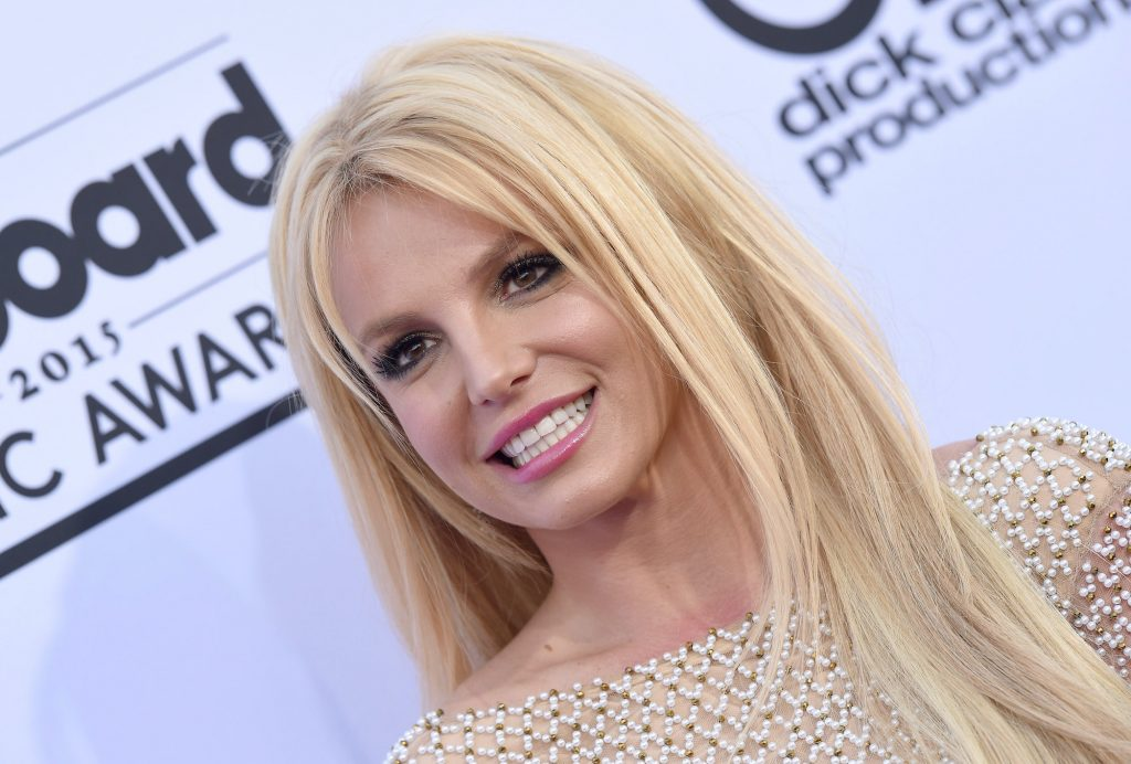 Britney Spears smiling in front of a white background