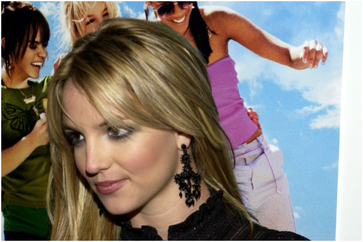 Britney Spears attending the 'Crossroads' premiere smiling while looking away from the camera.
