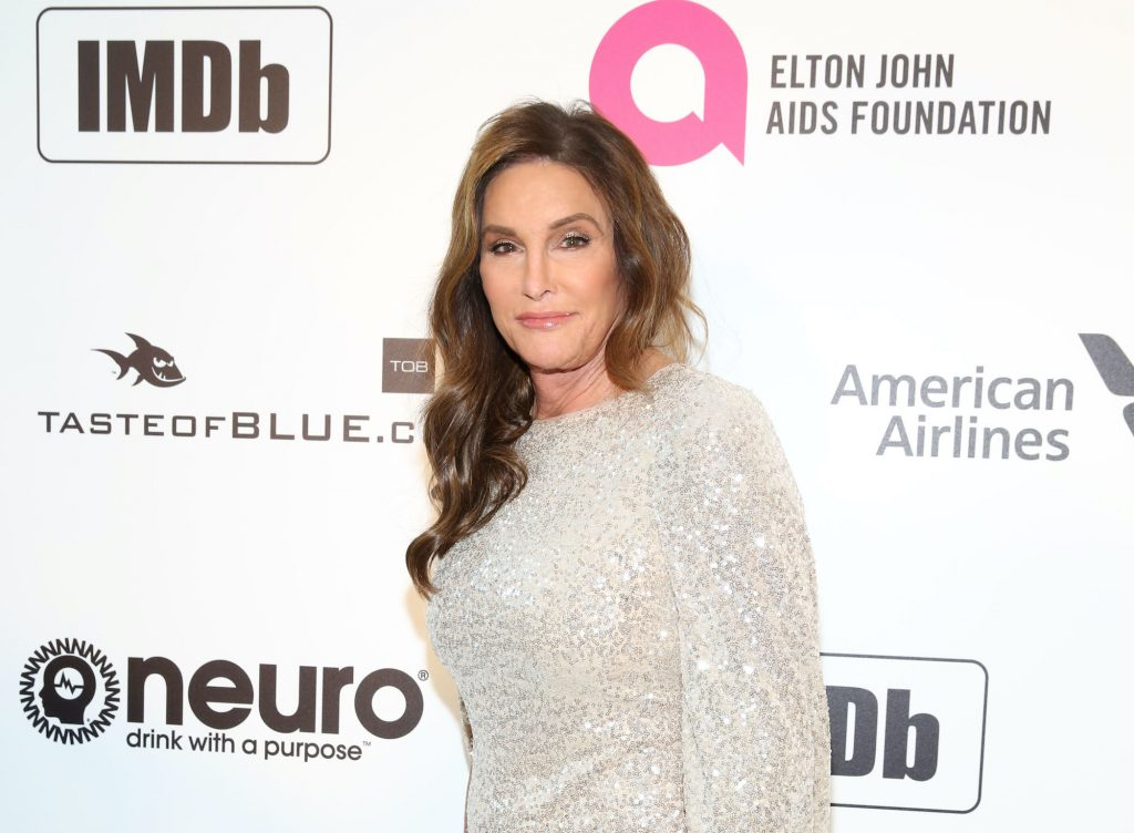 Caitlyn Jenner smiling in front of a white background