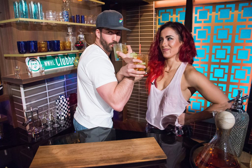 Johnny 'Bananas' Devenanzio holding a drink arm in arm with Cara Maria Sorbello from MTV's 'The Challenge'