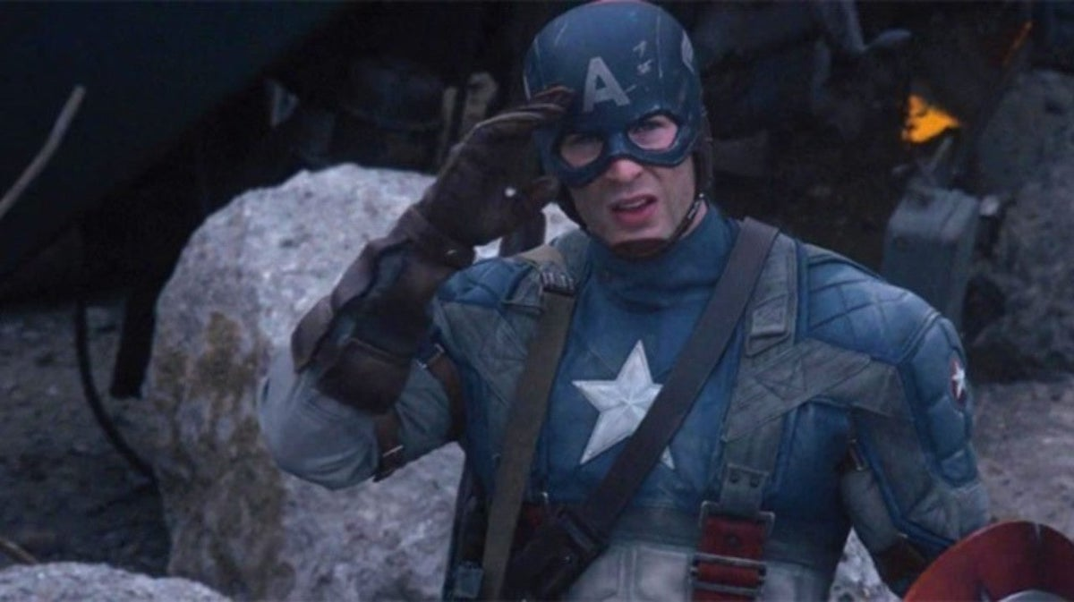 Captain America (Chris Evans) wears his red, white, and blue uniform and salutes in 'Captain America: The First Avenger'