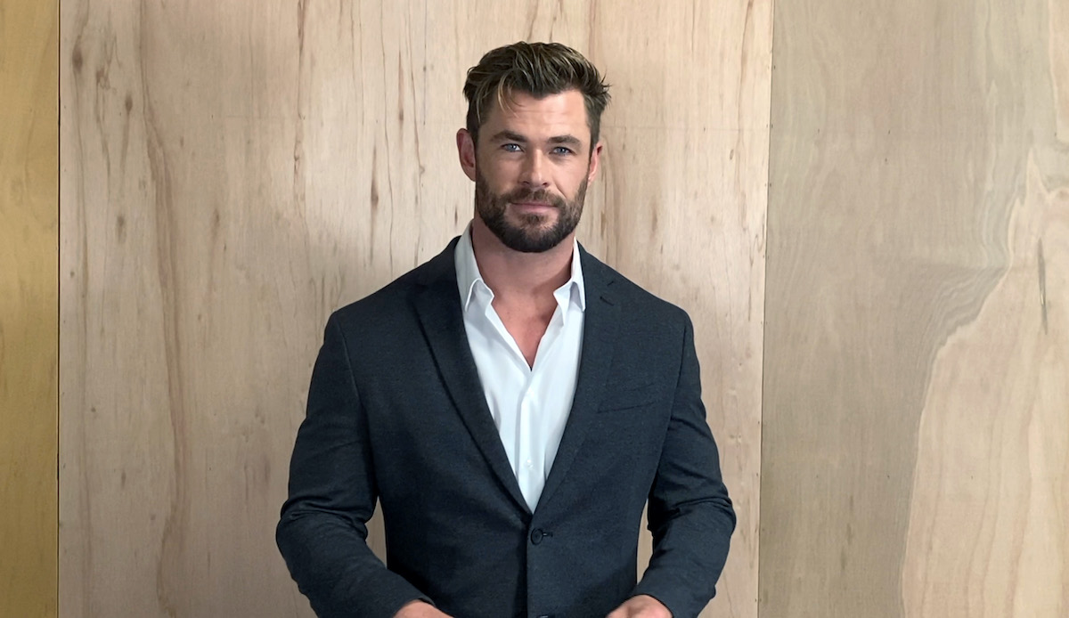 Chris Hemsworth wears a suit jacket and speaks at the 26th Annual Critics Choice Awards