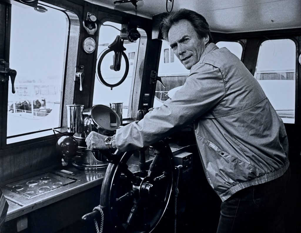 Clint Eastwood standing in his yacht