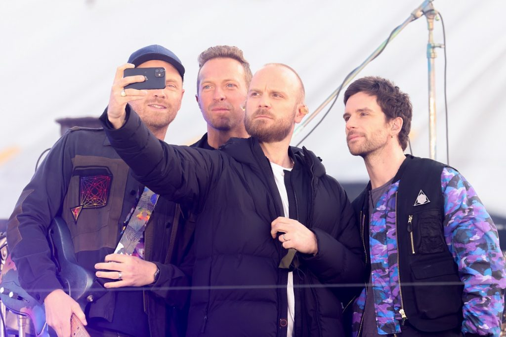 Coldplay members (l to r) Jonny Buckland, Chris Martin, Will Champion and Guy Berryman take a selfie during their performance at The Brit Awards 2021