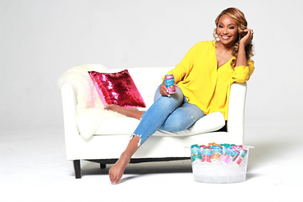 'The Real Housewives of Atlanta' star Cynthia Bailey sits behind a cooler of Seagram's Escapes.