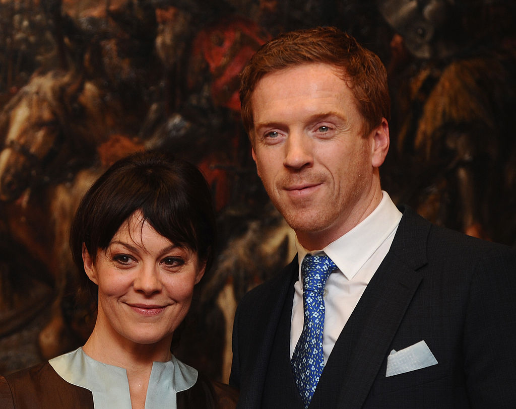 Damian Lewis and Helen McCroy pose together with smiles during Lewis' award ceremony.