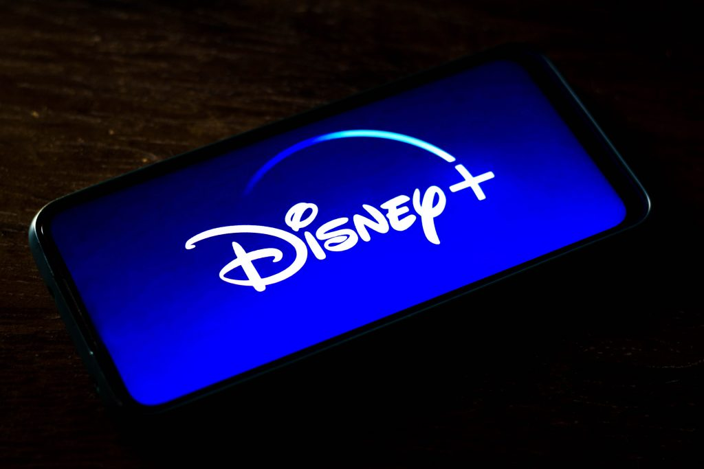 In this photo illustration the Disney+ logo seen displayed on a smartphone screen