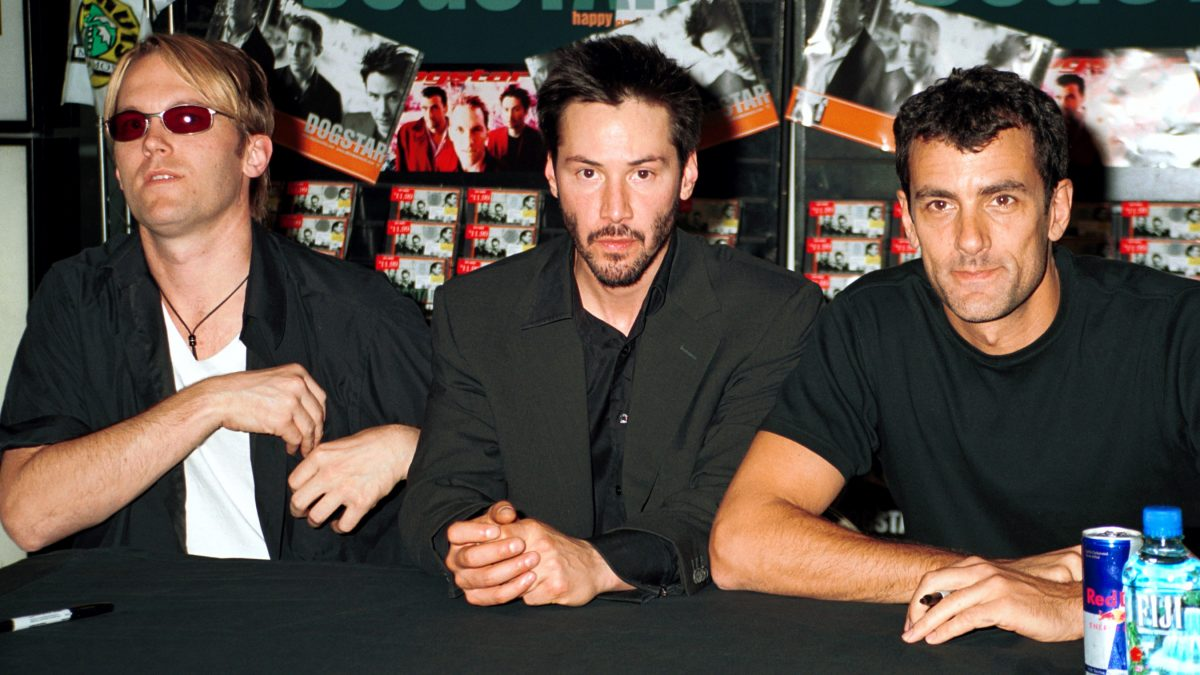 Dogstar trio sits at a record store table