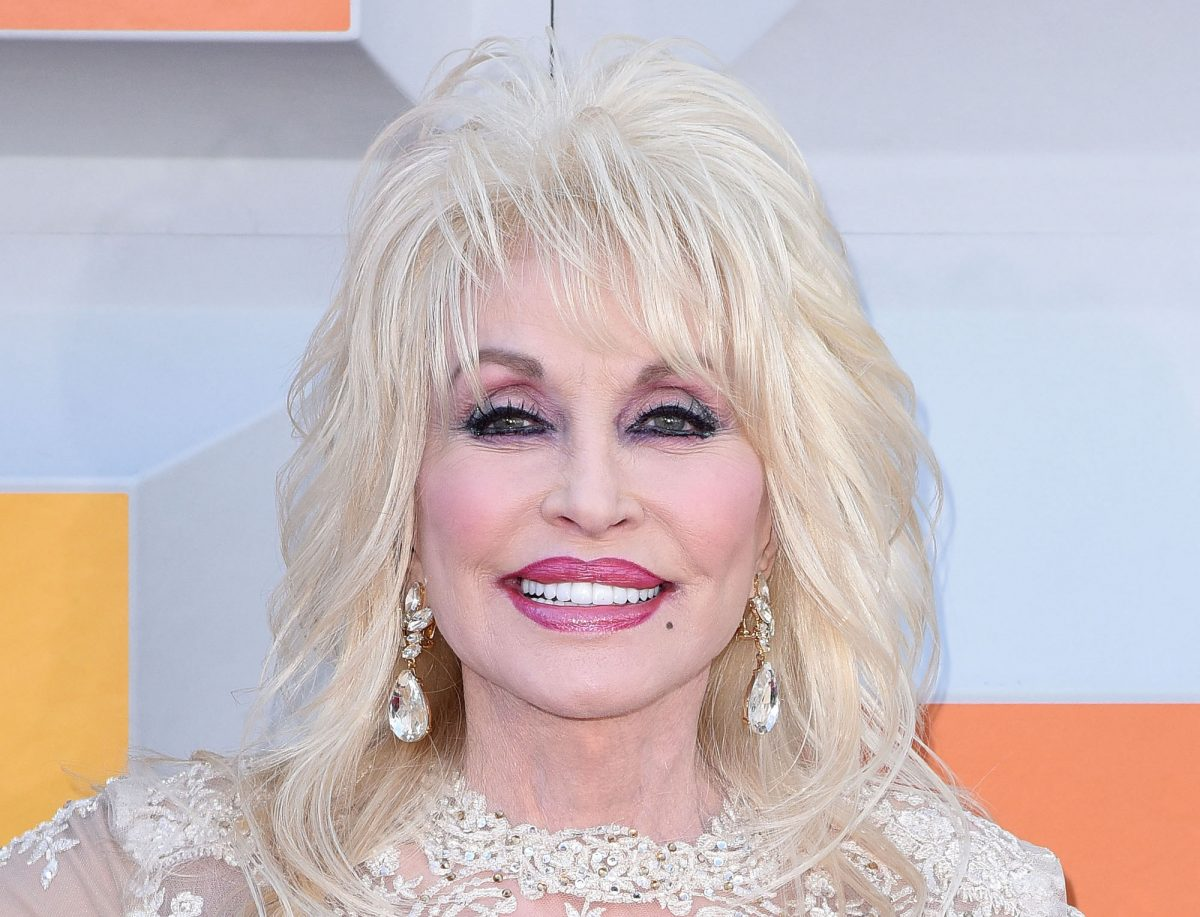 Dolly Parton posing on the red carpet at the 51st Academy Of Country Music Awards in 2016
