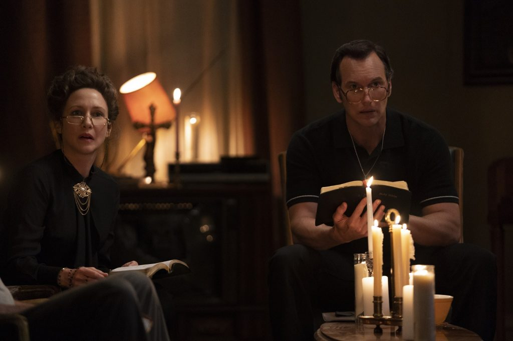 Ed and Lorraine Warren pray by candlelight