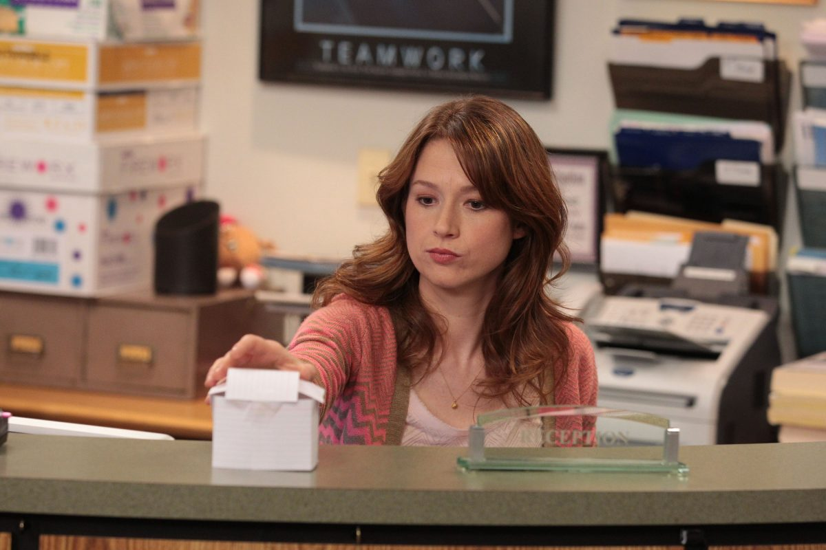 Ellie Kemper as Erin Hannon at the reception desk on 'The Office'