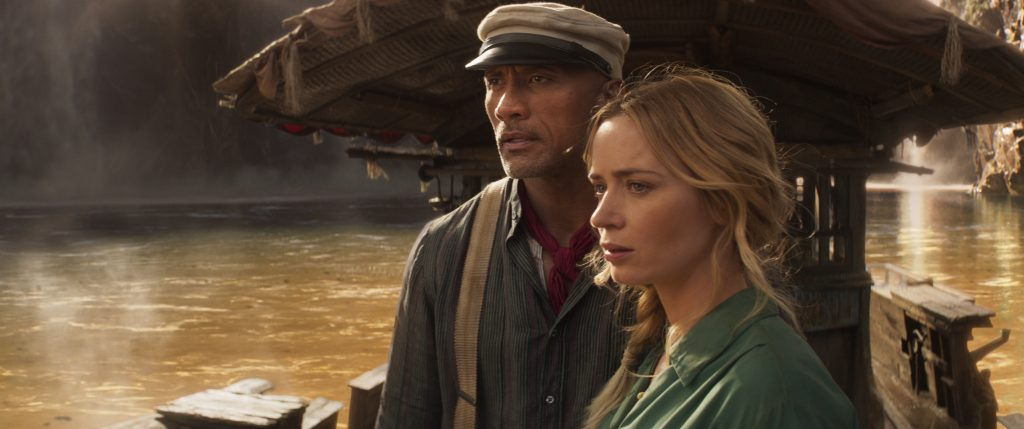 Emily Blunt and Dwayne 'The Rock' Johnson star in Disney's original movie, 'The Jungle Cruise' looking off into the distance in a still from the film