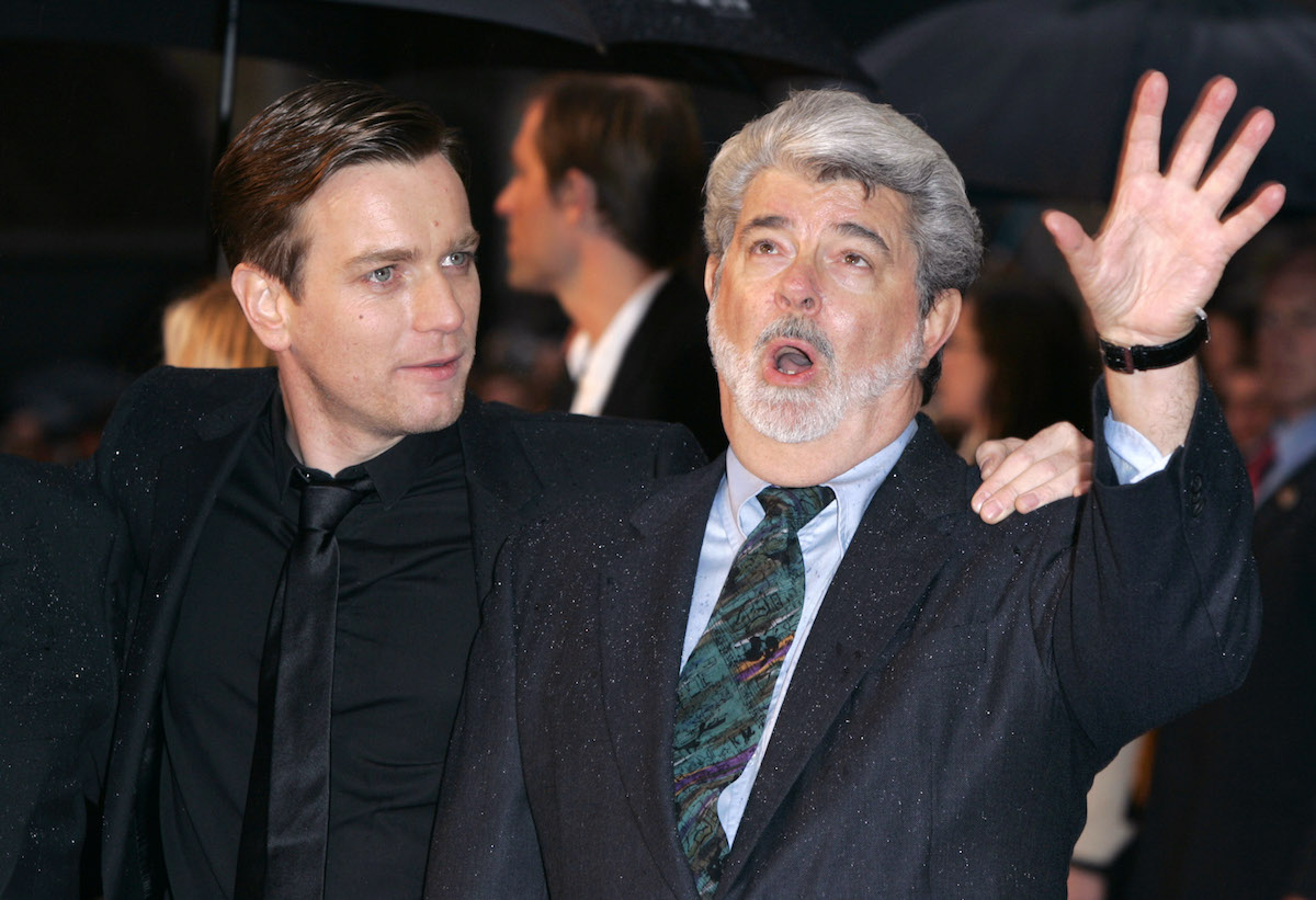Ewan McGregor stands next to George Lucas, who is speaking, at the UK premiere of 'Star Wars: Episode III — Revenge Of The Sith'
