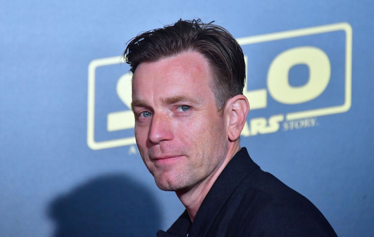 Ewan McGregor wears black and smiles at the 'Solo: A Star Wars Story' premiere