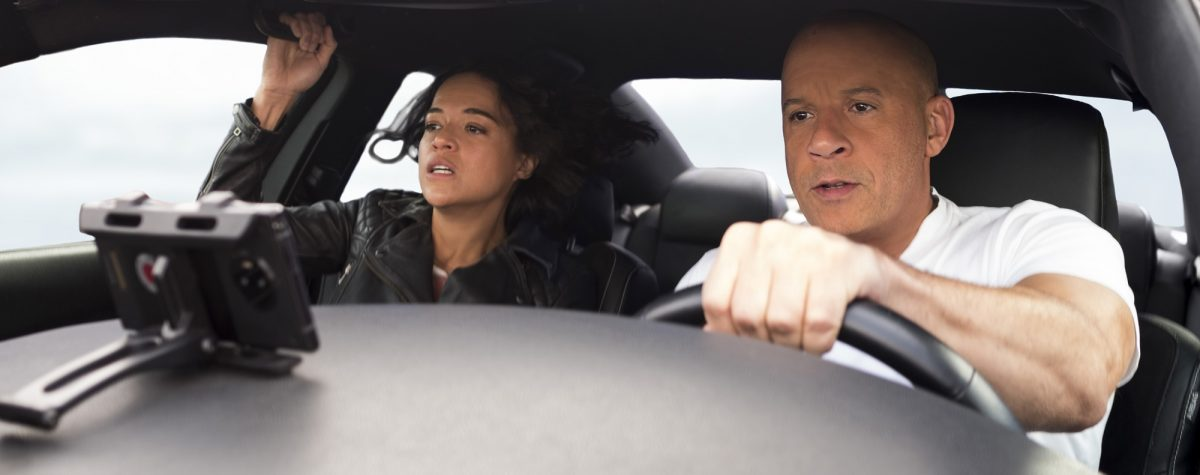 F9: Vin Diesel behind the wheel and Michelle Rodriguez in the passenger seat