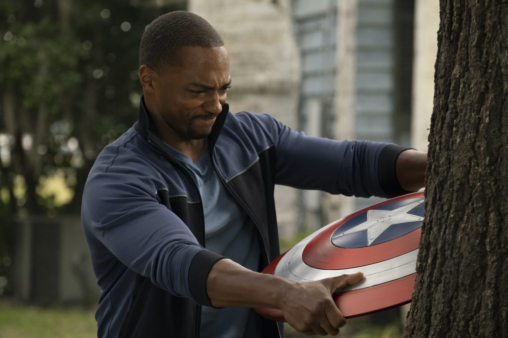 Marvel's original Disney+ series, 'The Falcon and the Winter Soldier' featuring Anthony Mackie as Sam Wilson pulling the shield out of a tree