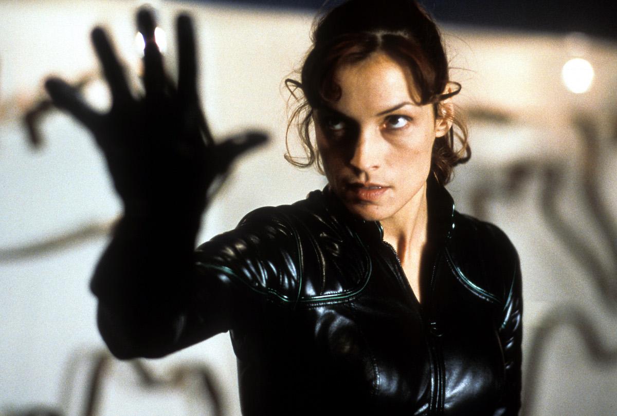 Famke Janssen holds up her hand as Jean Grey in 'X-Men'