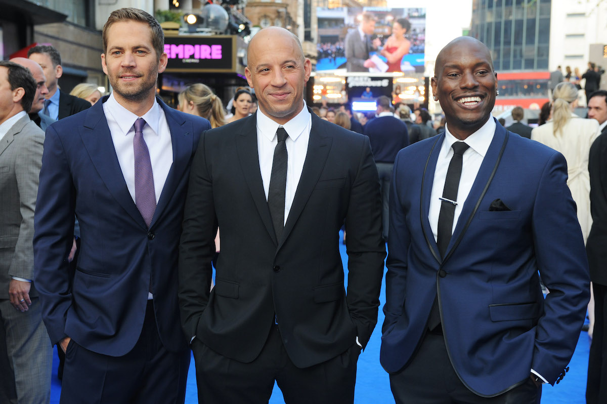 'Fast & Furious 6' stars Paul Walker, Vin Diesel, and Tyrese Gibson wear suits and smile at the movie's premiere