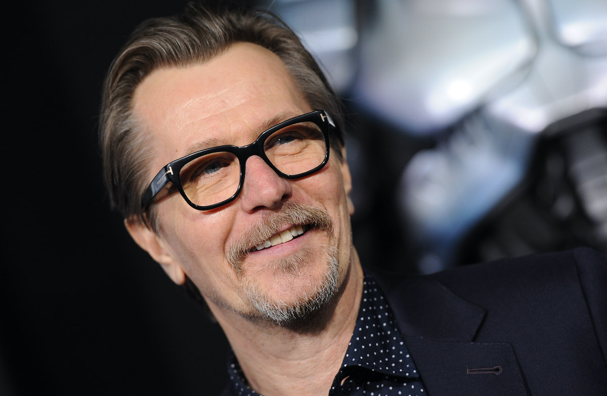 Gary Oldman smiles at a red carpet event