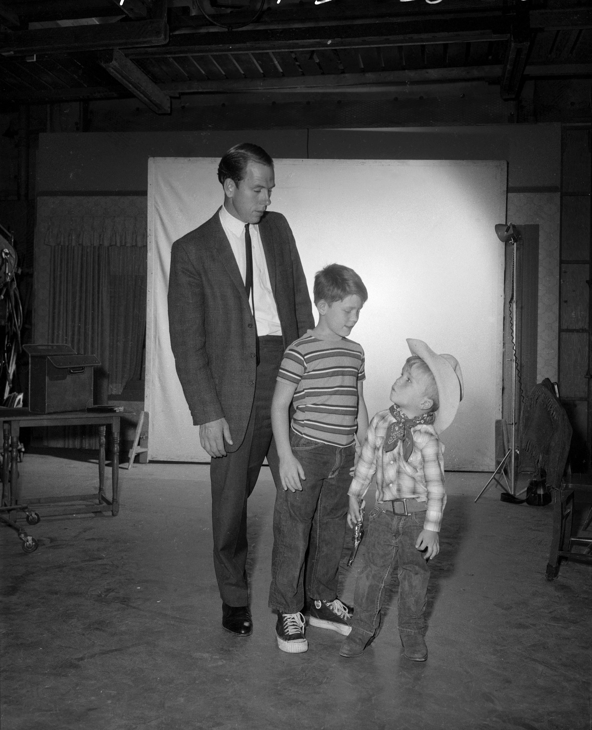 (left to right): Rance Howard with his sons, actors Ron Howard and Clint Howard on 'The Andy Griffith Show' set in 1963
