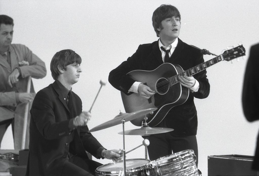 Ringo Starr, left, and John Lennon perform during the filming of 1964's 'A Hard Day's Night'