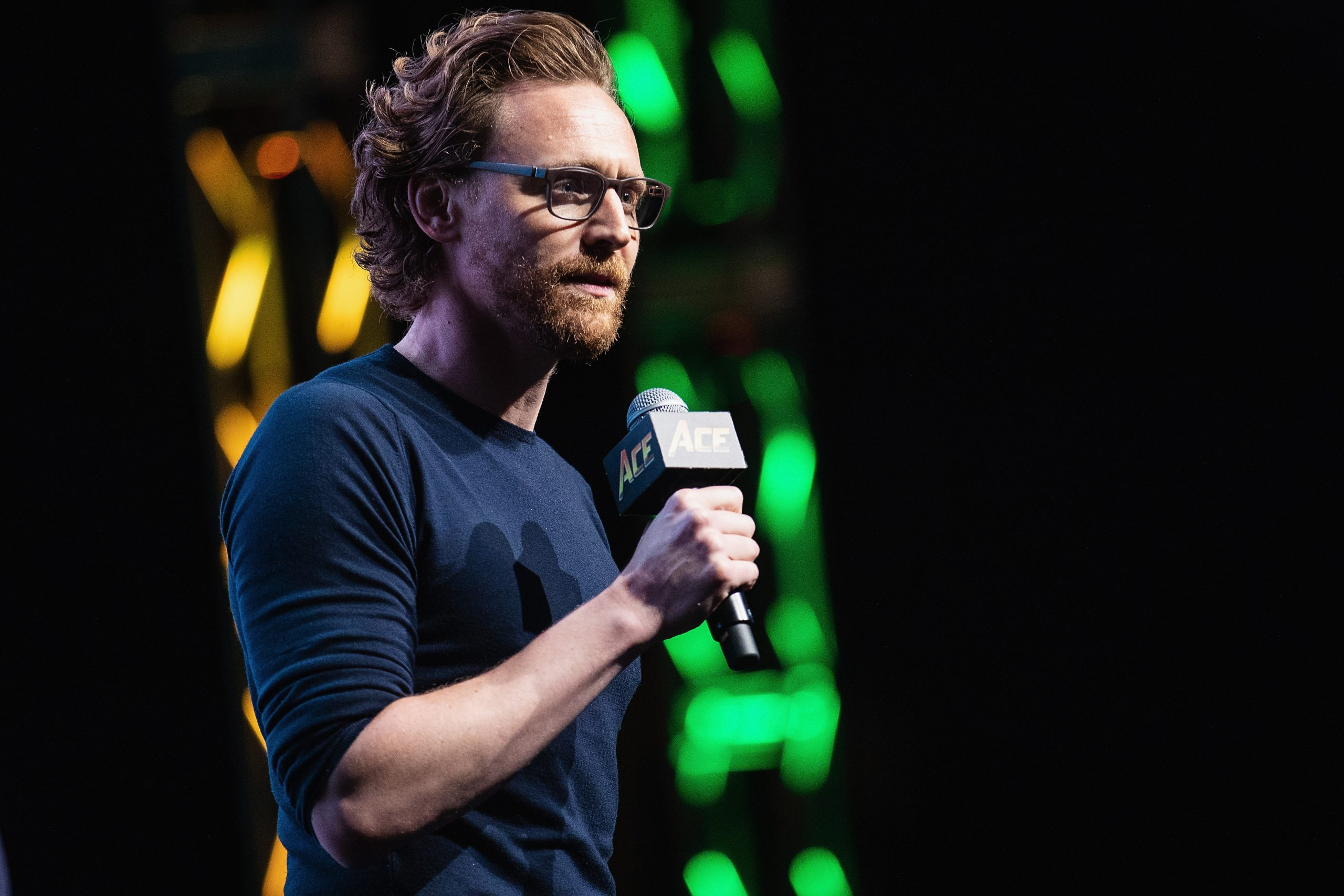 Tom Hiddleston speaks on stage about life as Loki in the Marvel Universe during ACE Comic Co