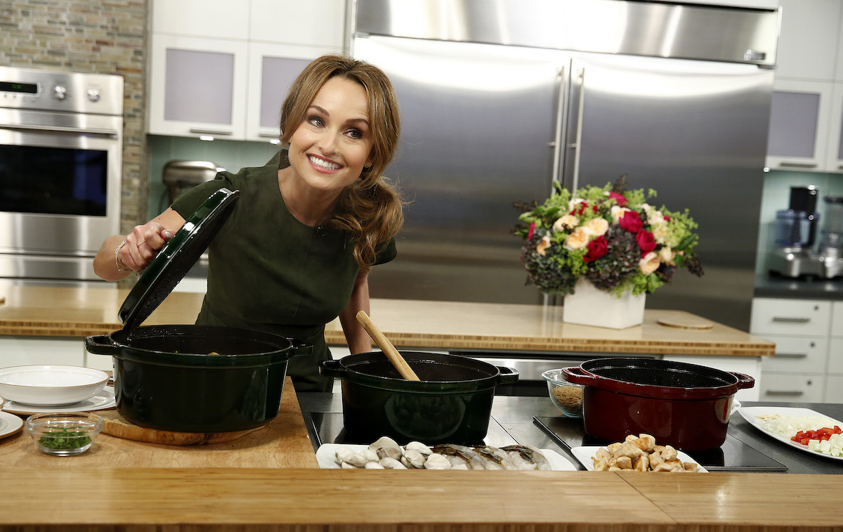 Giada De Laurentiis smiles as she lifts the lid on a pot during a cooking segment on the 'TODAY' show Season 62 in 2013