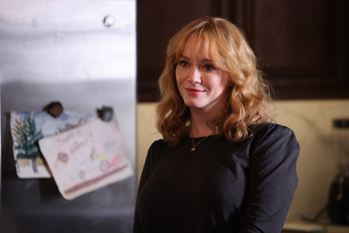 Christina Hendricks smiling while filming a scene of 'Good Girls' as Beth Boland.