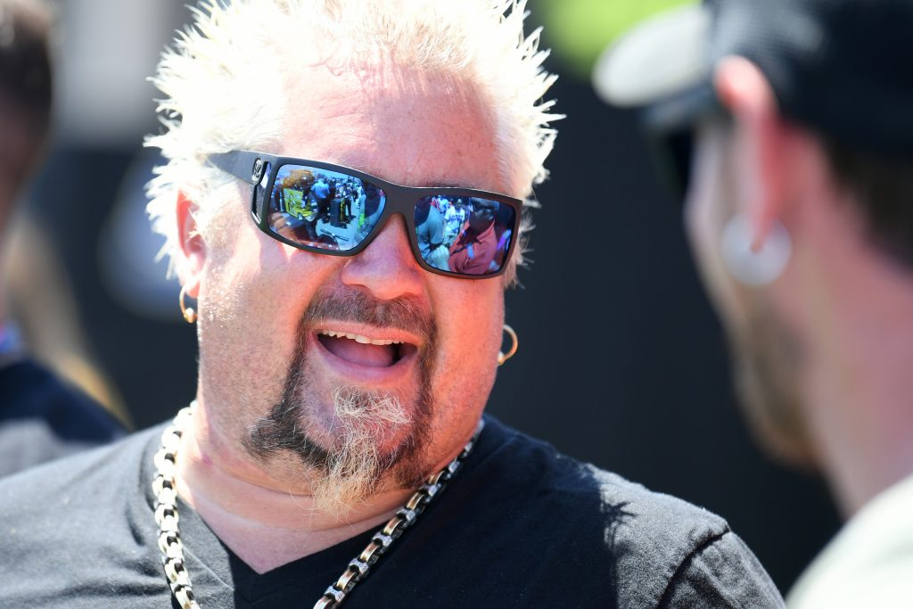 Celebrity chef Guy Fieri hangs out during qualifying for the Monster Energy NASCAR Cup Series Toyota/Save Mart 350 at Sonoma Raceway on June 22, 2019 in Sonoma, California.