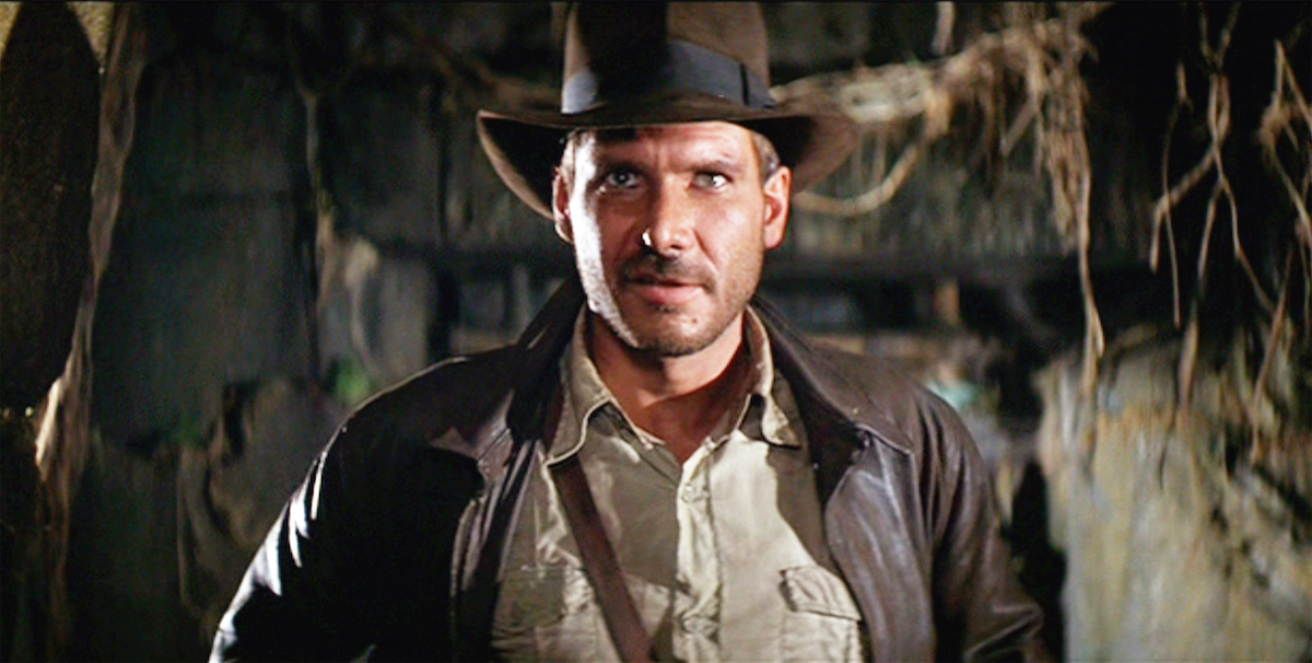Harrison Ford as Indiana Jones wears his signature brown jacket and fedora in a scene from 'Raiders of the Lost Ark'