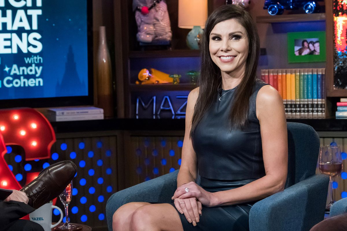 'RHOC' cast member Heather Dubrow sitting in black dress on 'Watch What Happens Live'