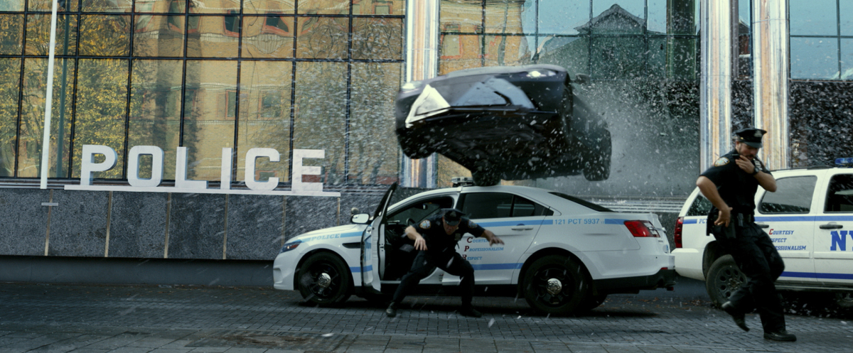 Infinite: A car drives through the police station