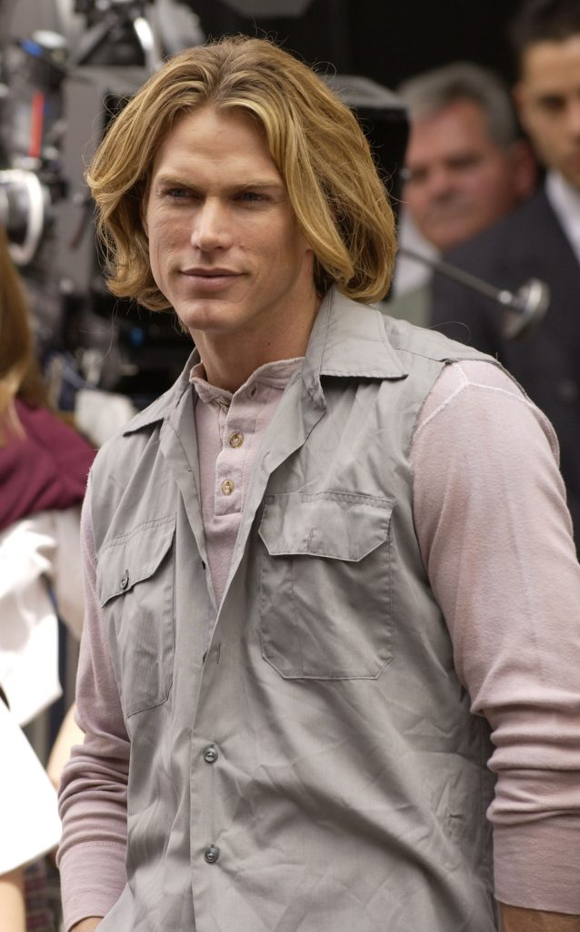 Jason Lewis as Smith Jerrod stands on a street corner on the Upper West Side during the filming of 'Sex and the City'