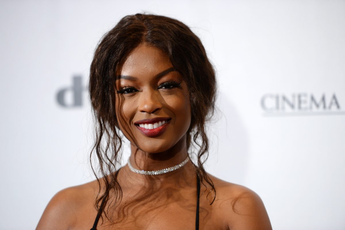 'Batwoman' star Javicia Leslie with her hair pulled back and wearing a necklace on the red carpet