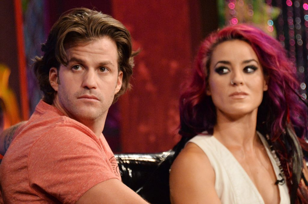 Johnny 'Bananas' Devenanzio and Cara Maria Sorbello sitting next to each other at MTV's 'The Challenge: Rivals II' final episode and reunion party
