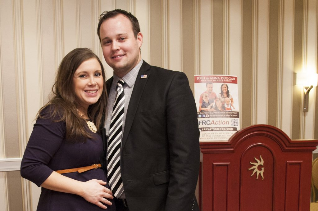 Pregnant Anna Duggar smiling at the camera with Josh Duggar of the Duggar family from TLC posing during the 42nd annual Conservative Political Action Conference (CPAC)